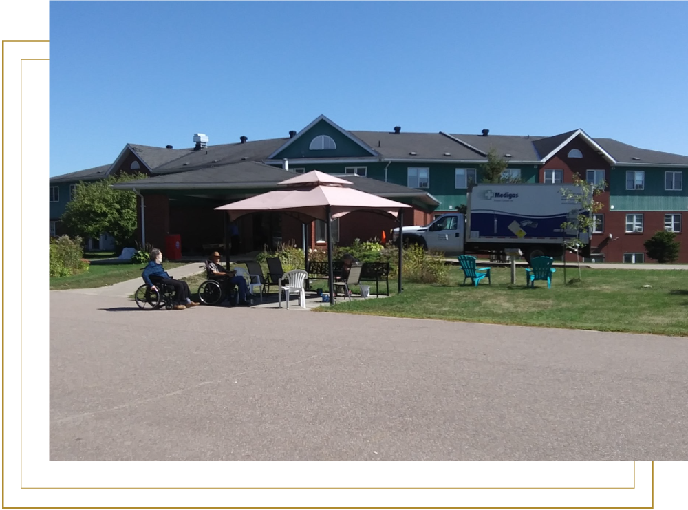 Country Haven Front Entrace with Residents in Wheelchairs