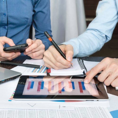 Vista Property Management - Marketing Services (Two Business People Looking at Marketing Analytics on a Tablet)
